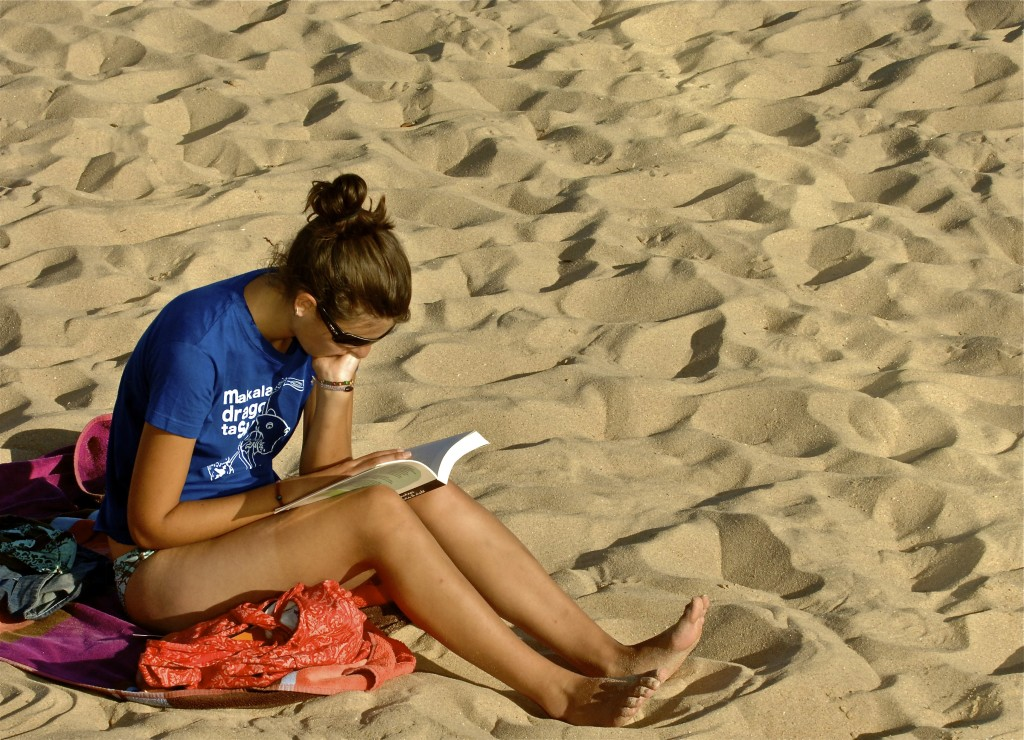 young woman reading a book on success